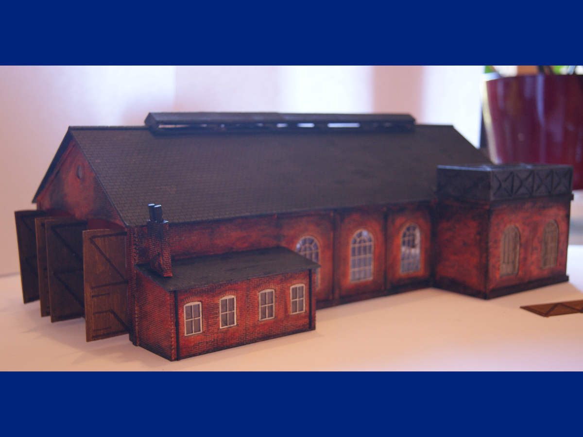 Masterfully assembled and painted double road engine shed B 00-10 with water tower LCC B 00-20 and joined office on the side. Submitted by Claire and Martin Gilmore on 12th June 2015