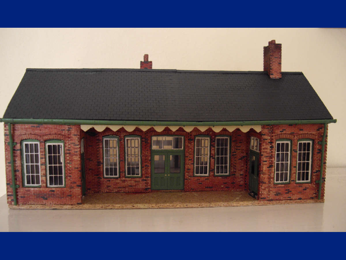 """This is my first attempt at constructing an LCUT building. It is based on station building 00-04 finished in Southern Railway colours with the addition of glazing and Ratio Models guttering and downpipes. Picking out individual bricks in a variety of colours added variety and was worthwhile despite being rather tedious!"" Submitted by Howard Pidd on 18th February 2015"