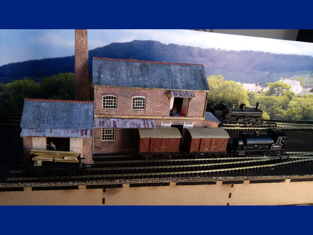 Warehouse, small goods shed and warehouse office combined to create the T Cooper Ltd Barrel makers. Buildings finished with scenic paper. Submitted by Ian Moore on 12th October 2015