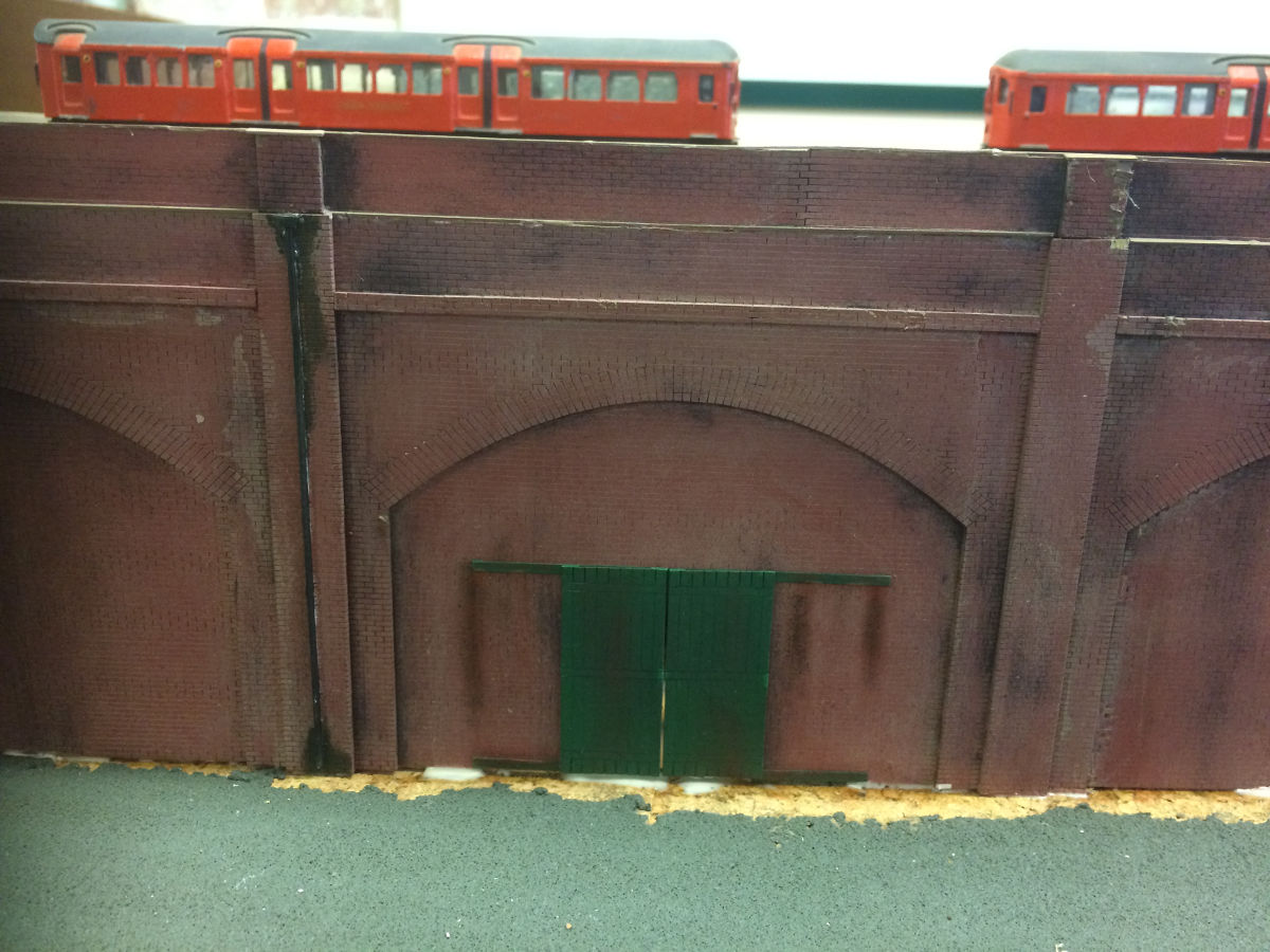 """A length of railway arches being test fitted to a club layout. Painted with car primer spray, watered-down colour testers, weathering powders and washes."" Submitted by Martin Hendry on 15th September 2017"
