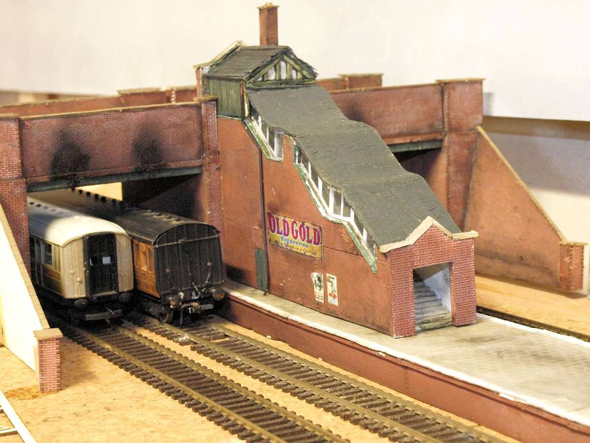 Bridge modified by Nigel Ford. With some added parts a stairway was created between two brick bridges (B 00-22). Also picture shows the B 00-07 platform in use. Submitted by Nigel Ford on 26th January 2015