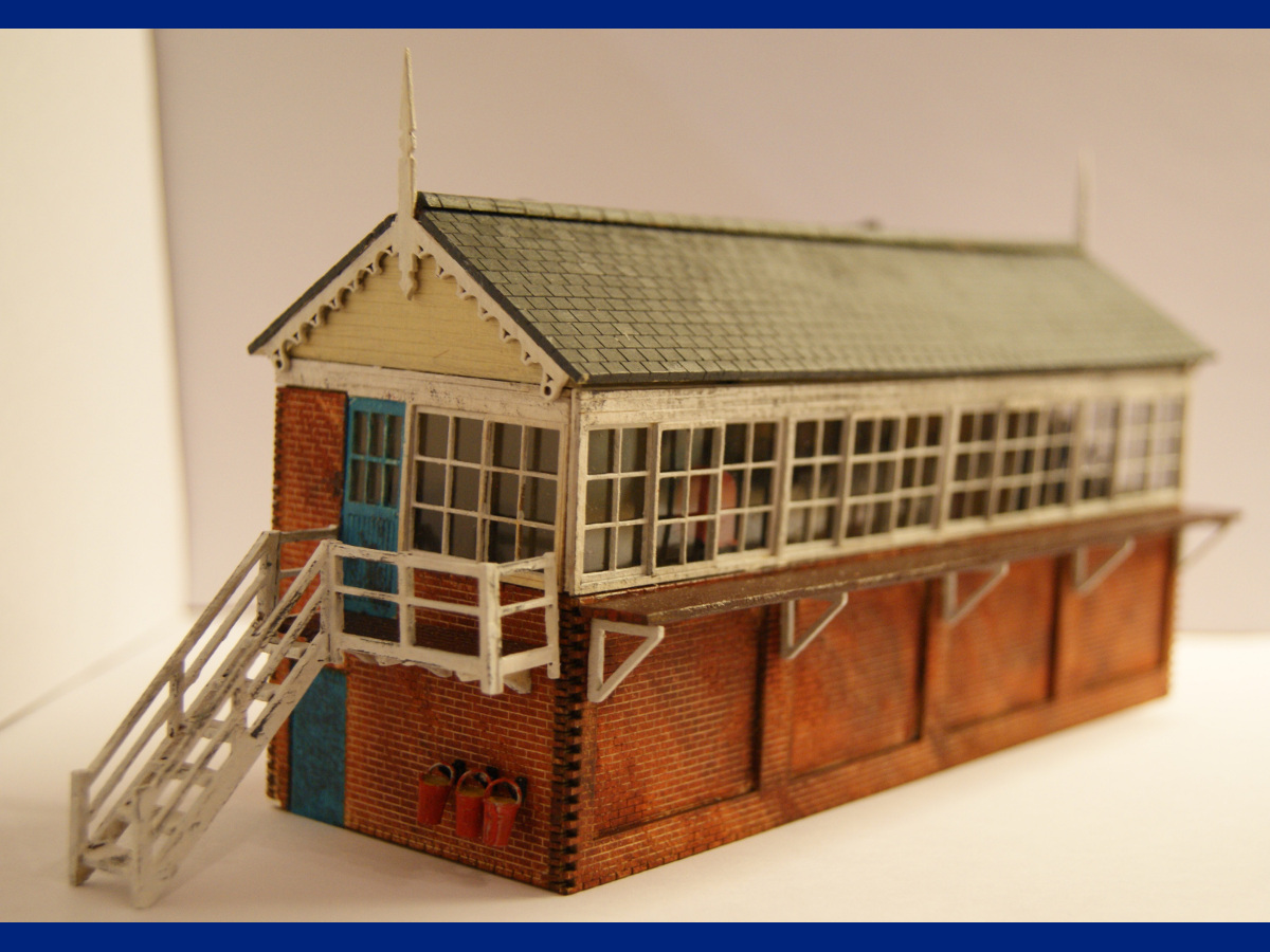 Another beautifully assembled and painted signal box by Claire and Martin. Modifications include the interior of the signal box and the front bottom windows blanked off. Submitted by Claire and Martin Gilmore on 16th March 2015